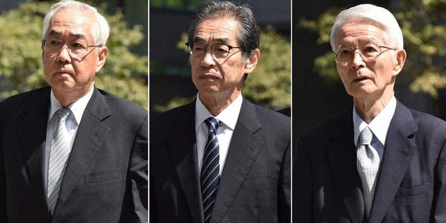 The three former executives from Tokyo Electric Power Company (TEPCO), former chairman Tsunehisa Katsumata (R), former vice presidents Ichiro Takekuro (C) and Sakae Muto (L), arriving at the Tokyo District Court to attend their trial