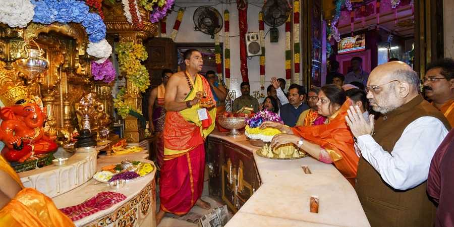 Home Minister Amit Shah and his wife Sonal Shah offer prayers at Siddhivinayak Ganapati Mandir on the occasion of 'Ganesh Chaturthi' festival in Mumbai Monday September 02, 2019