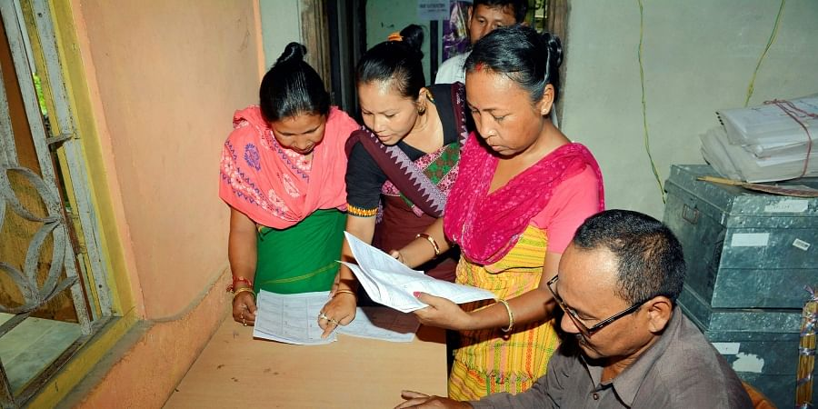 Bodo women check their names in the final list of National Register of Citizens NRC at an NRC Seva Kendra at Bagan Para in Baska district of Assam Monday September 2 2019. | PTI