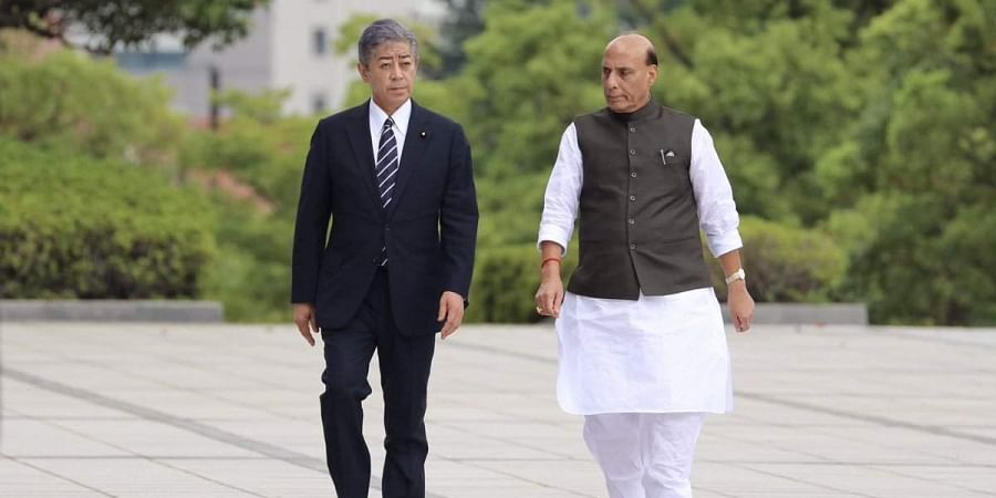 Defence Minister Rajnath Singh with his Japanese counterpart Takeshi Iwaya (L) in Tokyo