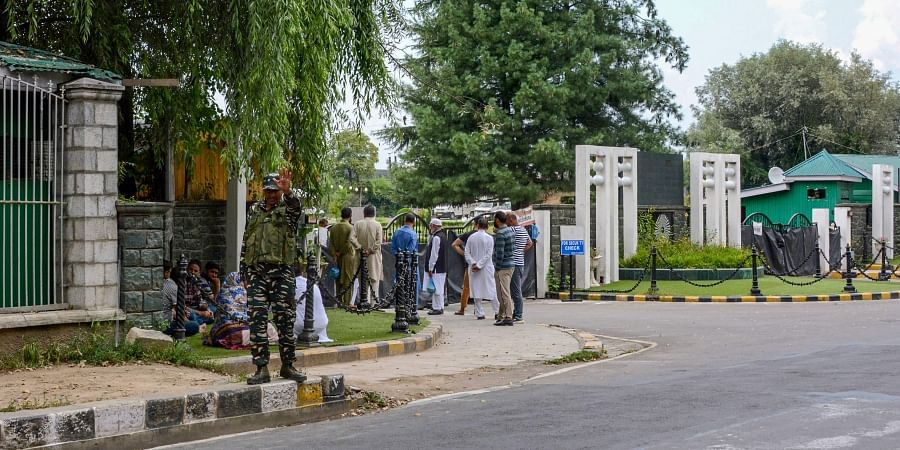 Relatives and supporters of top state leaders and former MLAs wait to meet them at SKICC where they have been put after their arrest after abrogration of the provisions of Article of 370 in Srinagar Monday September 2 2019. | PTI