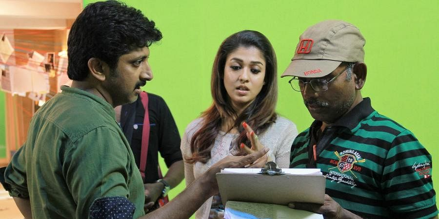 Ravi Chandran with Nayanthara and Mohan Raja during the filming of 'Thani Oruvan'.