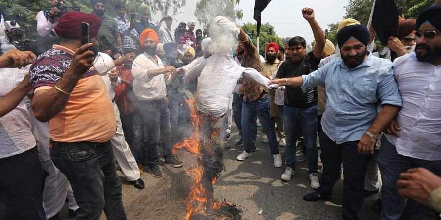 Sikh community burn an effigy representing Pakistan Prime Minister Imran Khan