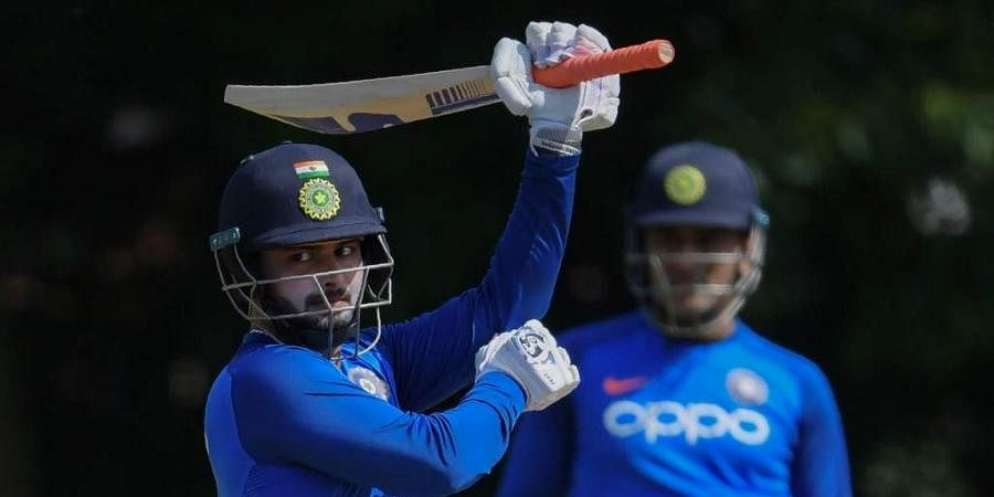 India's Rishabh Pant (L) is watched by Mahendra Singh Dhoni during a training session. (Photo | AFP)