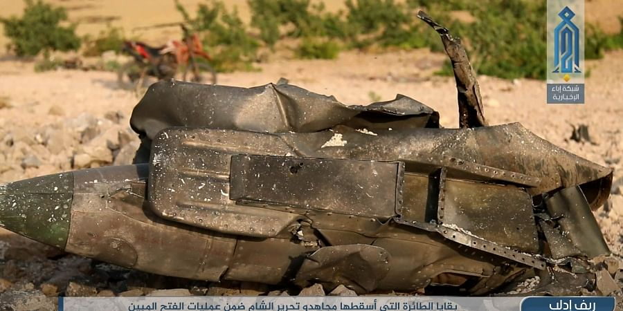 Part of a Syrian warplane that was shot down by rebel fighters over Idlib province in Syria.