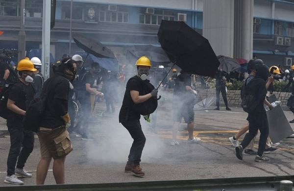 Hong Kong police, protesters clash in 16th weekend of rallies