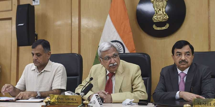 Chief Election Commissioner Sunil Arora flanked by Election Commissioners Ashok Lavasa (L) and Sunil Chandra during a press conference regarding Maharashtra and Haryana Assembly Elections at Election Commission in New Delhi Saturday September 21 2019. | P