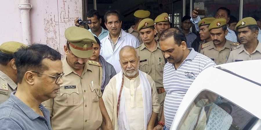 Former Union minister Swami Chinmayanand outside a government hospital after a medical examination following his arrest in Shahjahanpur, Uttar Pradesh. ( Photo | PTI)