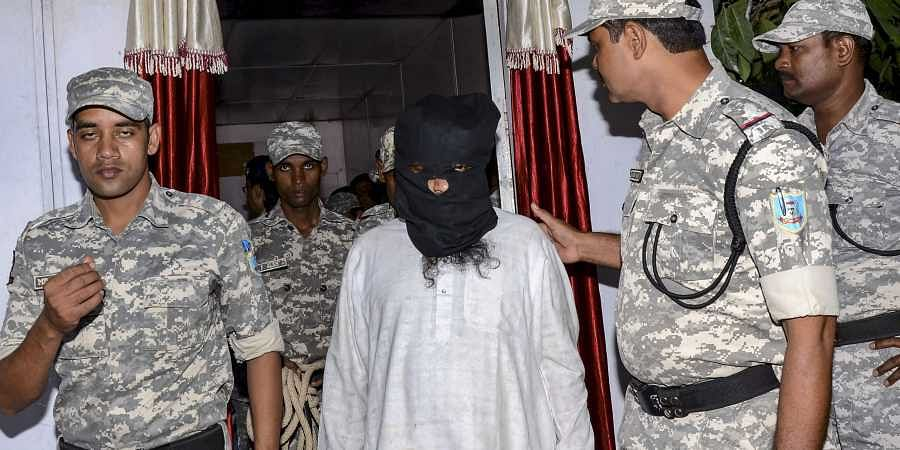 Al-Qaeda terrorist Mohammad Kalimuddin Mujahiri arrested by Anti Terrorist Squad ATS from Azad Nagar in Jamshedpur district being taken to a press conference in Ranchi Sunday.