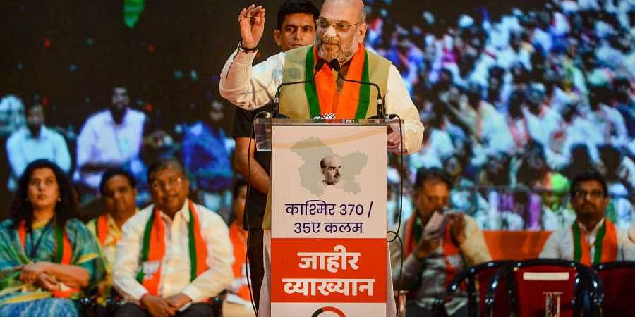 Home Minister Amit Shah speaks during a rally on the Centre's decision to abrogate Article 370 in Jammu and Kashmir and to campaign for next month's Maharashtra Assembly polls in Mumbai on Sunday.