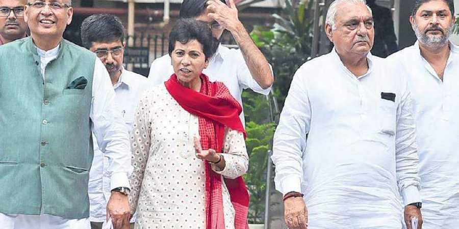 Haryana Congress president Kumari Selja (centre) and former CM Bhupinder Singh Hooda (right) have their task cut out in the northern state