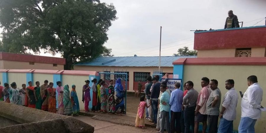 Tribal voters at a polling booth in Dantewada. | (Photo | EPS)