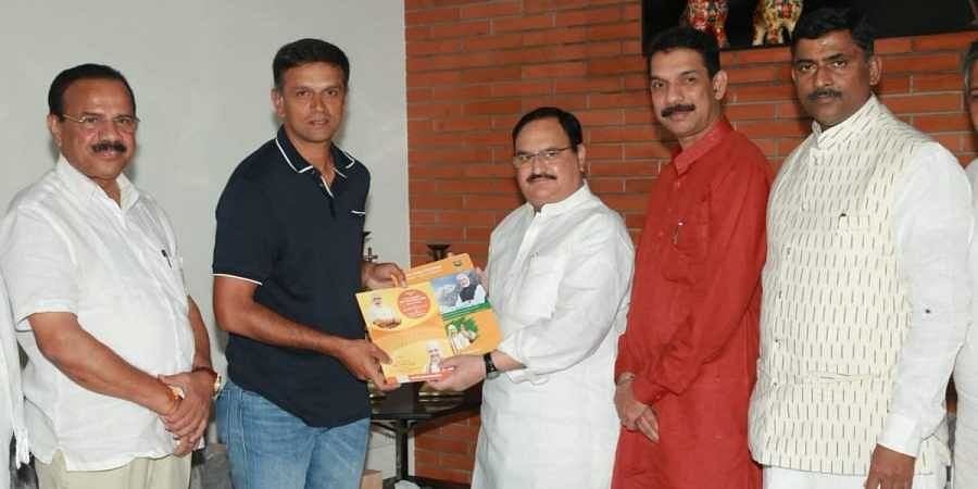 Former cricketer Rahul Dravid with BJP working president JP Nadda