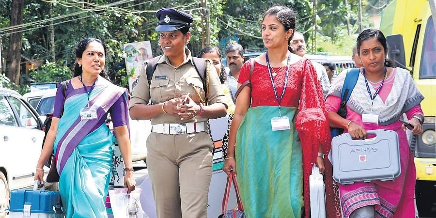 The polling officials assigned to the lone pink booth (all-woman polling booth) set up at St Vincent's English Medium School, Kizhathadiyoor, heading to the booth after collecting polling materials from Carmel School, Pala, on Sunday