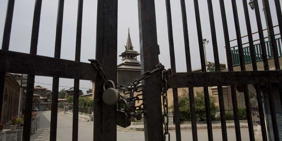Grand mosque stands locked during restriction in downtown Srinagar.