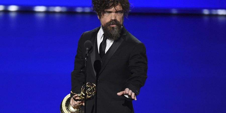 Peter Dinklage accepts the award for outstanding supporting actor in a drama series for 'Game of Thrones' at the 71st Primetime Emmy Awards.
