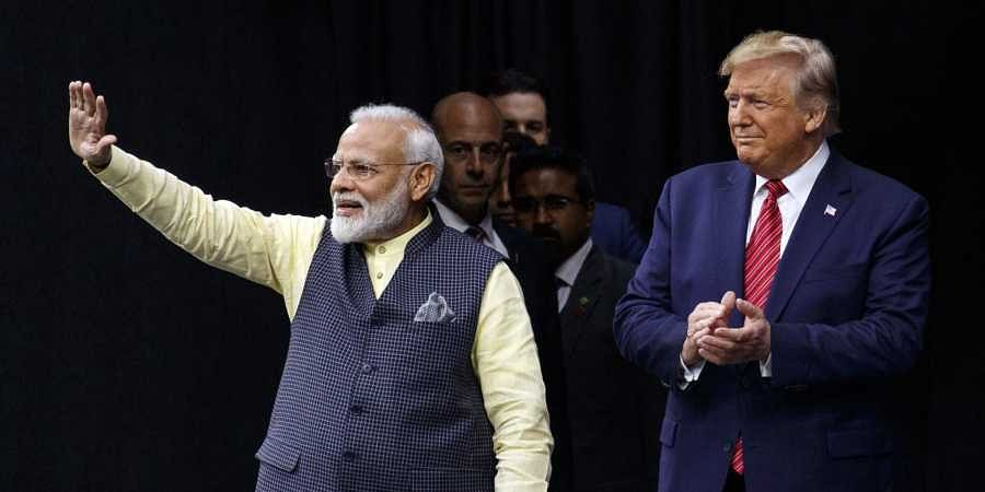 President Donald Trump stands on stage with Indian Prime Minister Narendra Modi at NRG Stadium, Sunday, Sept. 22, 2019, in Houston, during a 'Howdy Modi: Shared Dreams, Bright Futures' event. | (Photo | AP)