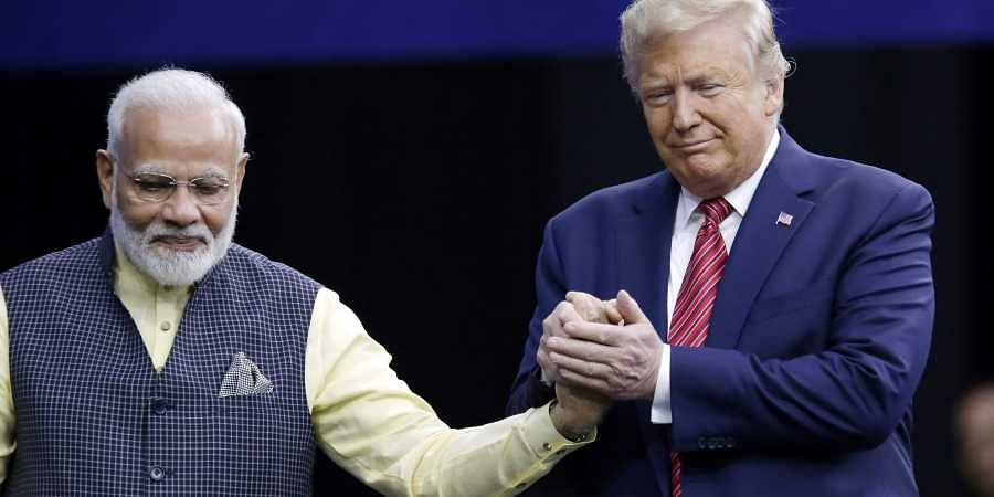 Prime Minister Narendra Modi and President Donald Trump shake hands after introductions during the 'Howdi Modi' event Sunday, Sept. 22, 2019, at NRG Stadium in Houston. | (Photo | AP)