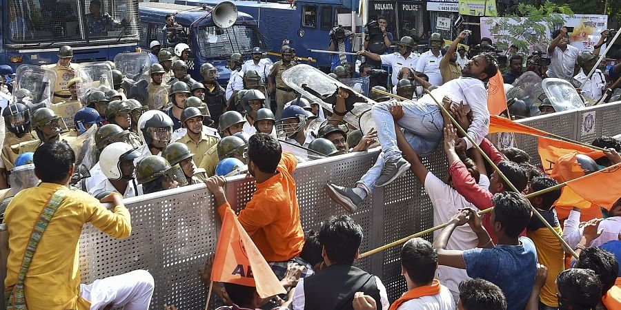 ABVP activists attempt to break a police cordon during their march towards Jadavpur University in protest against attack on Central Minister Babul Supriyo at Jadavpur University on September 19 in Kolkata Monday September 23 2019. | (Photo | PTI)