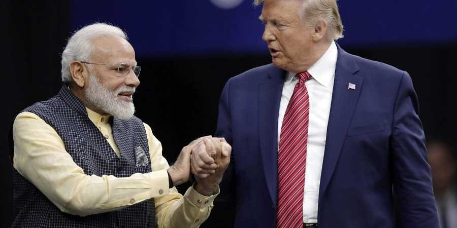 Prime Minister Narendra Modi and President Donald Trump shake hands after introductions during the 'Howdi Modi' event. (Photo | AP)