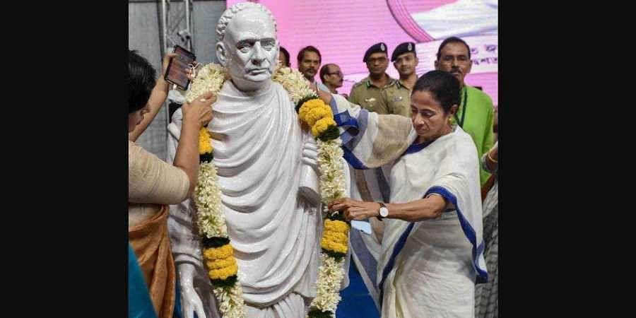 Chief Minister Mamata Banerjee garlanding a statue of Vidyasagar. (Photo| PTI)