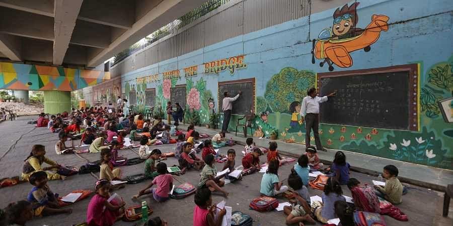 Rajesh Kumar Sharma runs 'The Free School Under The Bridge' in Delhi's Yamuna Bank area. (Photo | Arun Kumar, EPS)