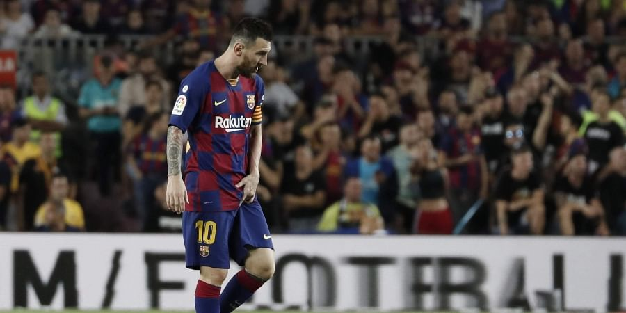 Barcelona's Lionel Messi walks on the pitch after getting hurt during the Spanish La Liga soccer match between FC Barcelona and Villarreal CF at the Camp Nou stadium in Barcelona, Spain.(Photo | AP)
