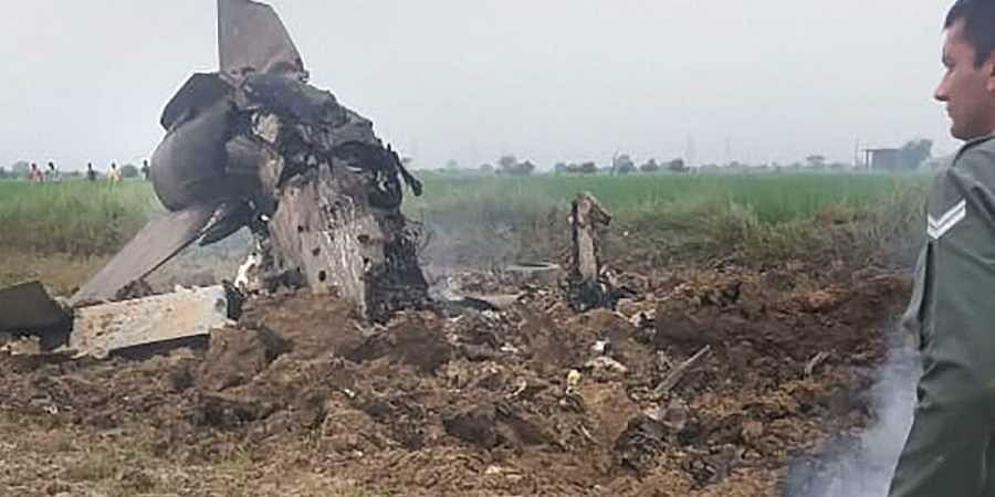 An Indian Air Force official inspect the site where MiG-21 trainer jet crashed near the Gwalior airbase Wednesday September 25 2019. | (Photo | PTI)