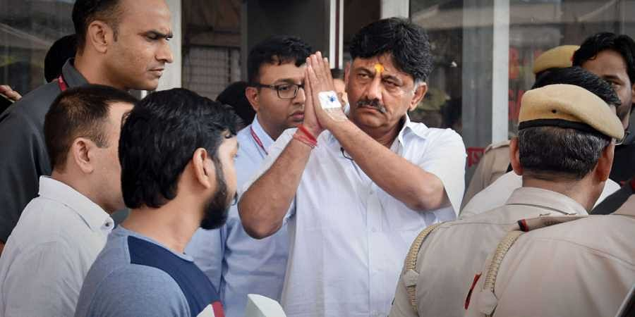 Congress leader DK Shivakumar leaves the ED office before being produced at a special court in connection with a money-laundering probe against him in New Delhi