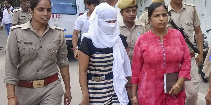 The woman law student who alleged BJP leader Chinmayanand of sexual misconduct and harassment being taken to the court after she was taken into custody by the Special Investigation Team (SIT) on charges of alleged extortion and blackmail in Shahjahanpur Tuesday September 24, 2019. | (Photo | PTI)