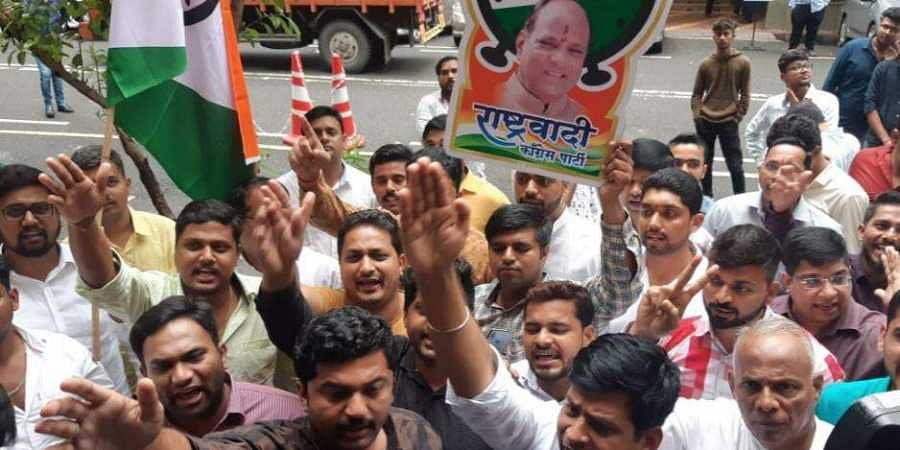 NCP's youth wing staged a protest outside the Enforcement Directorate office, Mumbai.
