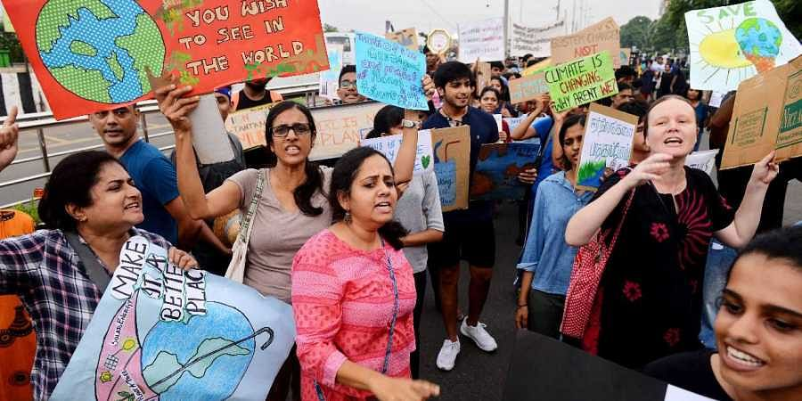 Hundreds of people throng to Elliot's Beach to hold a peaceful rally spreading awareness against Climate Change and urging government to act against it in Chennai on Sunday.