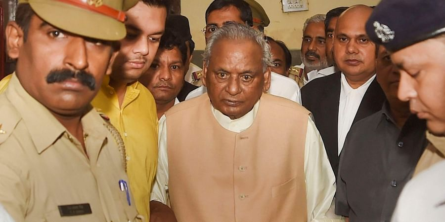 BJP leader and former Uttar Pradesh chief minister Kalyan Singh leaves after appearing before a special CBI court in connection to its summons in the Babri Masjid demolition case in Lucknow.
