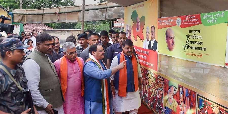 BJP Working President JP Nadda (Second from Right) with West Bengal BJP leader at an exhibition before his address on the abolishment of Article 370 in Kolkata.
