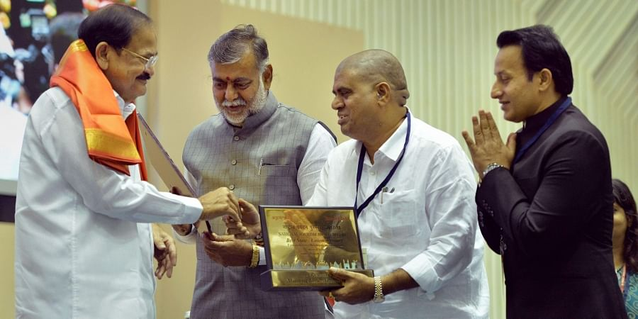 Vice President M Venkaiah Naidu presents the Comprehensive Development of Tourism Rest of India Award to the state of Andhra Pradesh during an event on World Tourism Day 2019 and National Tourism Awards 2017-18 in New Delhi.