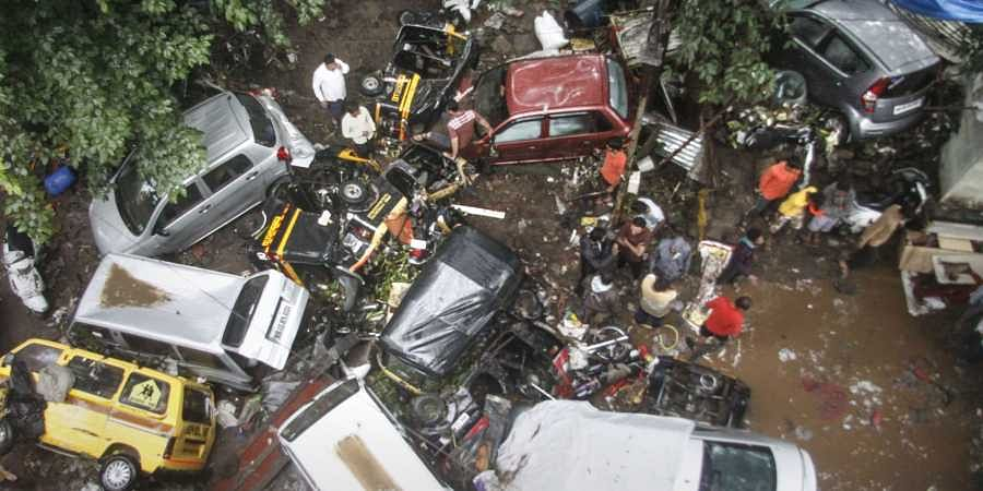 Vehicles are piled up on a street after a flash flood following heavy rains in Pune