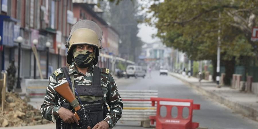 Security personnel stands guard during restrictions at Residency Road in Srinagar Friday Sept. 27 2019. | (Photo | PTI)