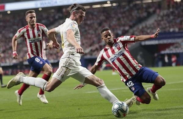 Real Hold Off Atletico In Tight Derby To Grab Top Spot In