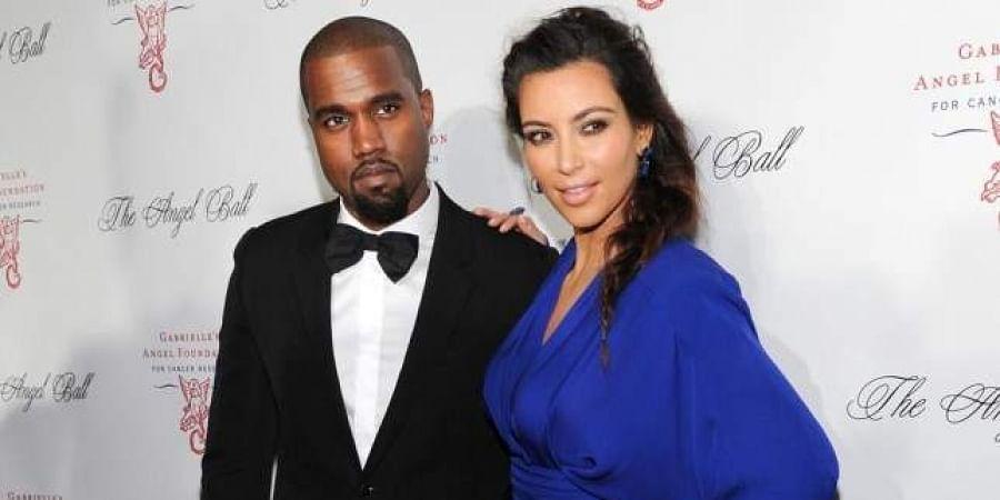 Reality TV star Kim Kardashian and her rapper husband Kanye West