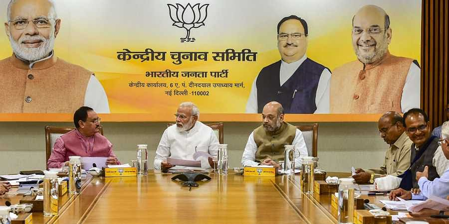 Prime Minister Narendra Modi flanked by Union Home Minister Amit Shah and BJP Working President JP Nadda during party's Central Election Committee CEC meeting in New Delhi. (Photo | PTI)