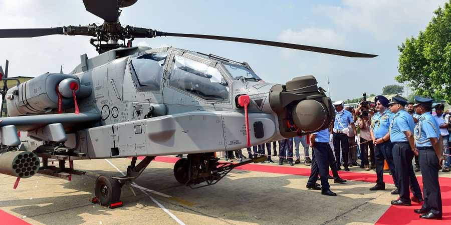 Air Chief Marshal Birender Singh Dhanoa inspects an Apache attack helicopter during the induction ceremony of eight US-made Apache AH-64E helicopters into the Indian Air Force at Airforce Station Pathankot Tuesday September 3 2019. | PTI