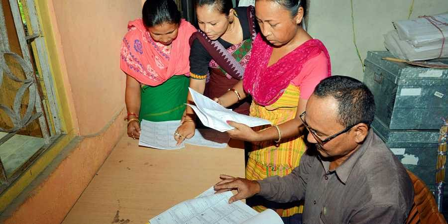 Bodo women check their names in the final list of National Register of Citizens NRC at an NRC Seva Kendra at Bagan Para in Baska district of Assam Monday September 2 2019.   PTI