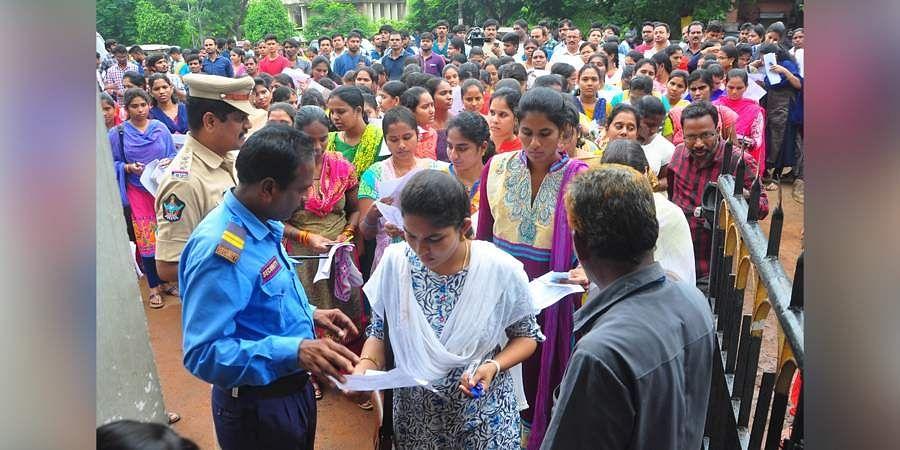 Peoples attend to Grama Sachivalayam Exam at Bullaya College In Visakhapatnam
