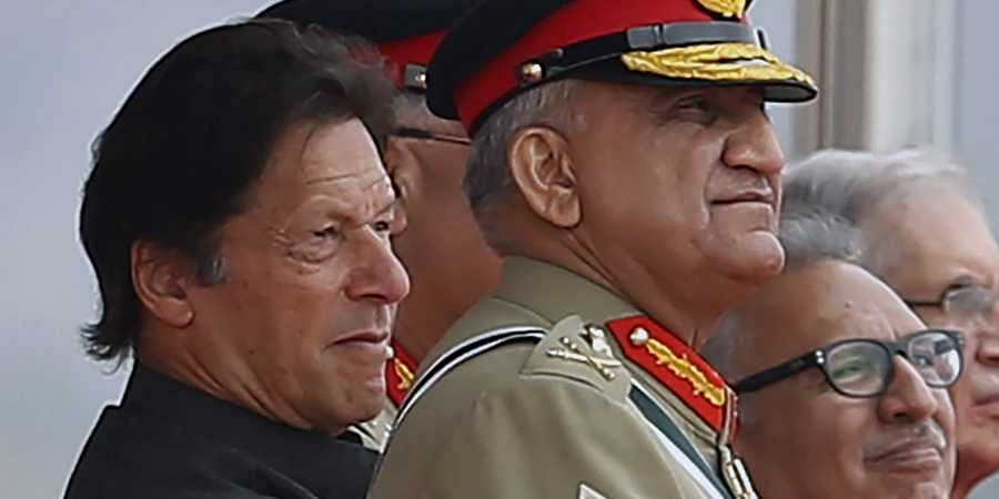 Pakistan's Army Chief Gen. Qamar Javed Bajwa, right, watches a parade with Prime Minister Imran Khan, left, in Islamabad, Pakistan, on 23/09/2019.