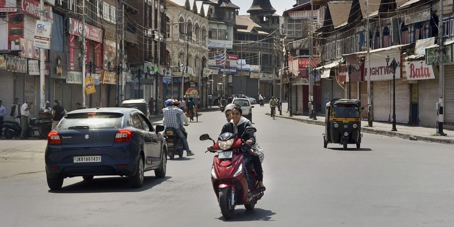 Commuters seen on a road near Lal Chowk on the 30th day of restriction after abrogration of the provisions of Article of 370 in Srinagar Tuesday September 3 2019. | PTI