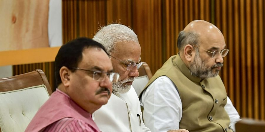 Prime Minister Narendra Modi flanked by Union Home Minister Amit Shah and BJP Working President JP Nadda during party's Central Election Committee CEC meeting in New Delhi Sunday Sept. 29 2019. | (Photo | PTI)