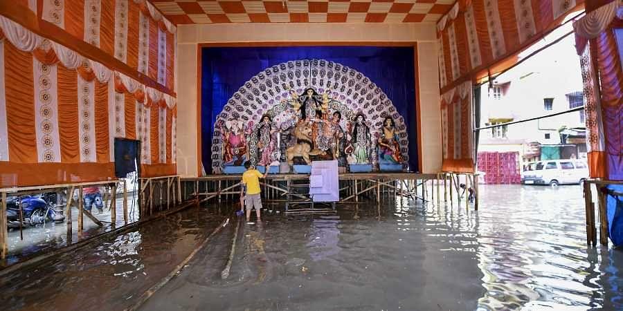 A view of waterlogged area near a Durga Puja community pandal following heavy monsoon rainfall in Kolkata Sunday Sept. 29 2019. | (Photo | PTI)
