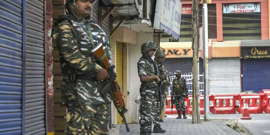 Security personnel stand guard during shutdown in Srinagar Sunday Sept. 29 2019. | (Photo | PTI)