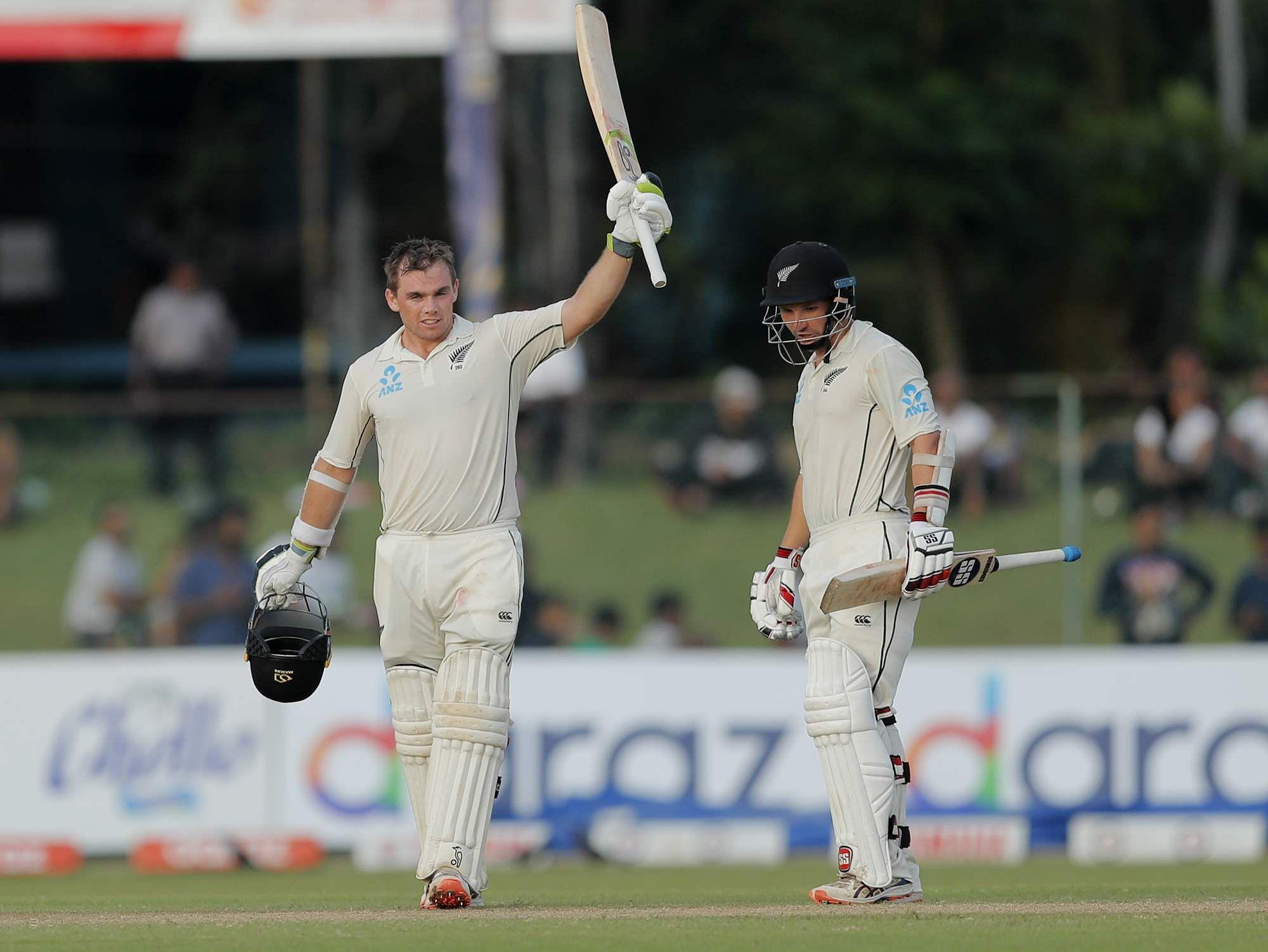 New Zealand's Tom Latham, left, celebrates scoring a century as BJ Watling watches. (Photo | AP)