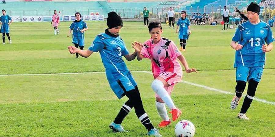 Afghanistan's Rabia Balkhi School girls (sporting head scarves) in action on Tuesday.